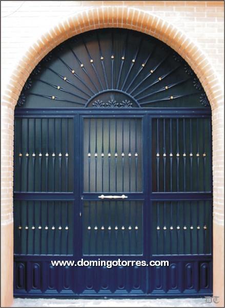 1010-Puerta forja latón y cuarterones