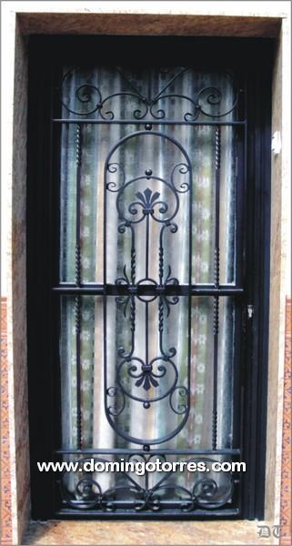 Puerta de entrada en hierro forjado para exteriores n 1036 for Puertas de hierro forjado para casas