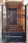 1616 Cancela hierro fundido y cuarterones